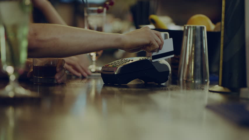 bartender gives a Terminal for payment #19890754