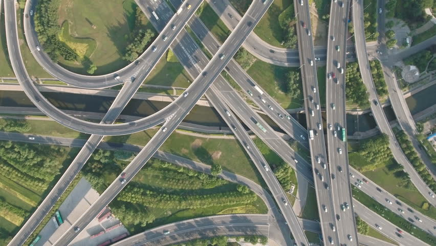 Panoramic aerial footage of a huge network of flyovers, junctions, intersections, roads, bridges etc in Zhengzhou, urban China.   Shutterstock HD Video #19909729