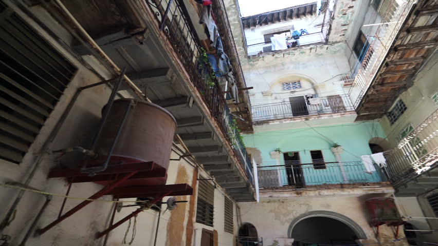 HAVANA, CUBA - AUGUST 15, 2016: Panoramic vertical horizontal view of interior of old ragged cuban courtyard with poor houses in Havana center at summer sunny day | Shutterstock HD Video #19929103