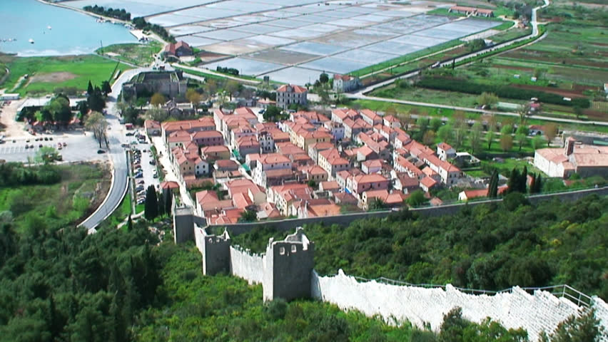 Second longest world walls. Ston small town near Dubrovnik with medieval Salt Basin, Croatia landscape in wide pan shot from top of the hill fortress.