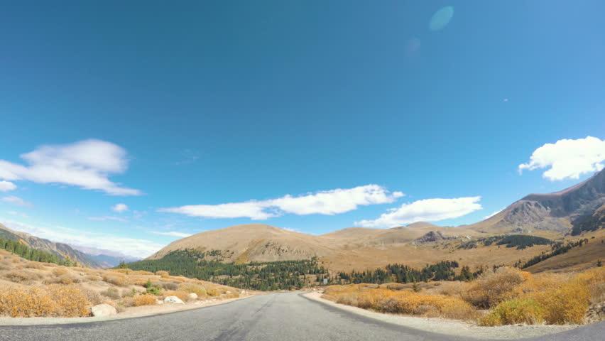 POV point of view - Driving through  alpine forest in the Autumn.POV point of view - Driving through  alpine forest in the Autumn.   Shutterstock HD Video #19974883