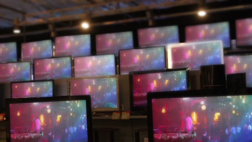 Many flat tv sets stay working on showcase in shop, Pavel Losevsky footage inserted on screen