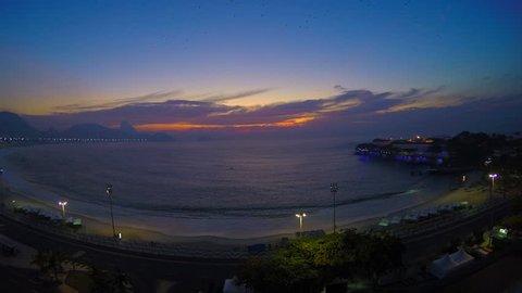 Time lapse shot at Copacabana beach - Rio de Janeiro - Brazil. Sunrise time.