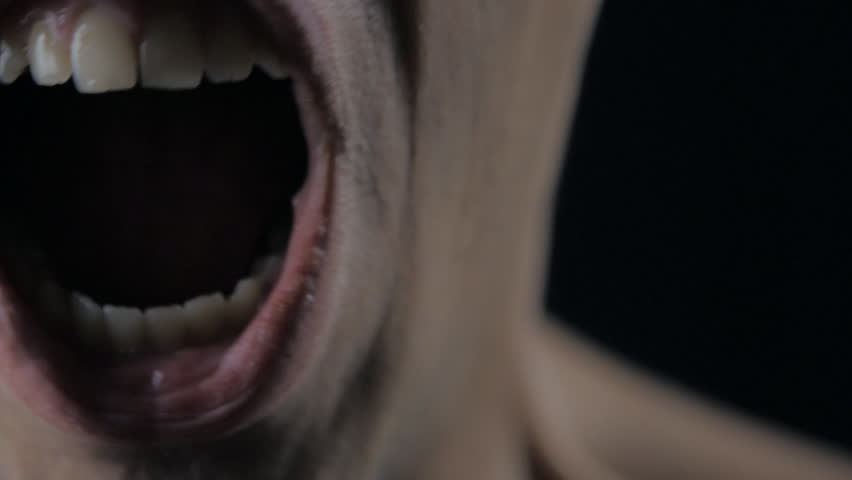 Close up mouth of Angry Man screaming. Danger Violence