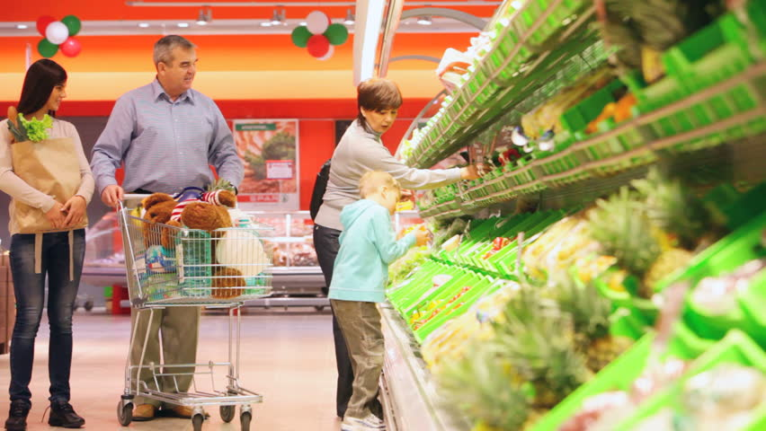 Family of four pushing cart full of products along the aisles in the mall | Shutterstock HD Video #2005163