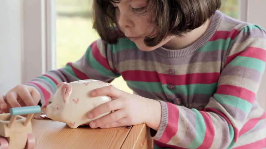 Little girl saving euros