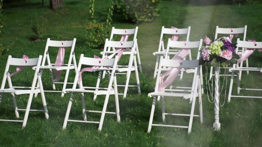 White Chairs With Pink Bows Waving In The Wind Wedding Decor For Registration