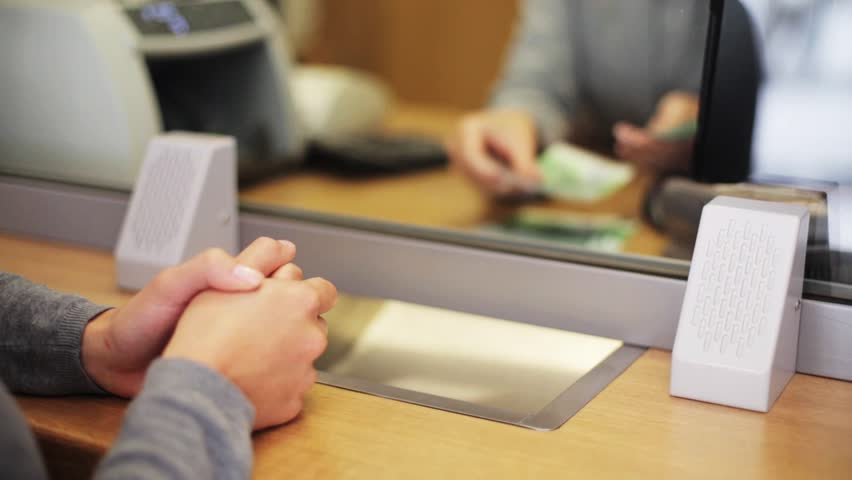 People, saving and finance concept - clerk counting euro cash money and customer at bank office | Shutterstock HD Video #20116513