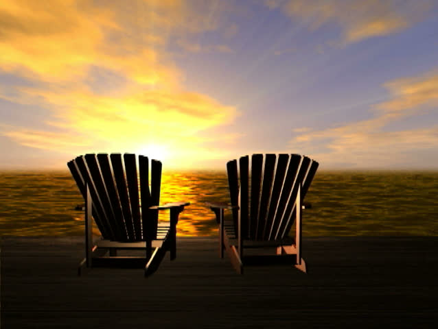 Beach Chairs Overlook A Sunset At The Ocean Stock Footage Video
