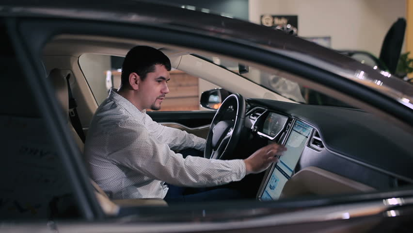 Caucasian Man Touching The Touchscreen Of Car Console At The