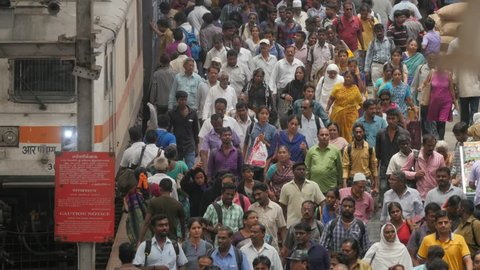 Chennai, India - April 20,2016: Crowded platform with commuter in central station