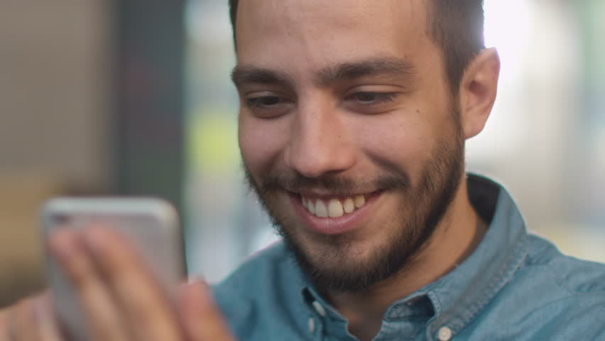 Hispanic Ethnicity Young Man using Mobile Phone at Cozy Coffee Shop. Shot on RED Cinema Camera in 4K (UHD). | Shutterstock HD Video #20204173