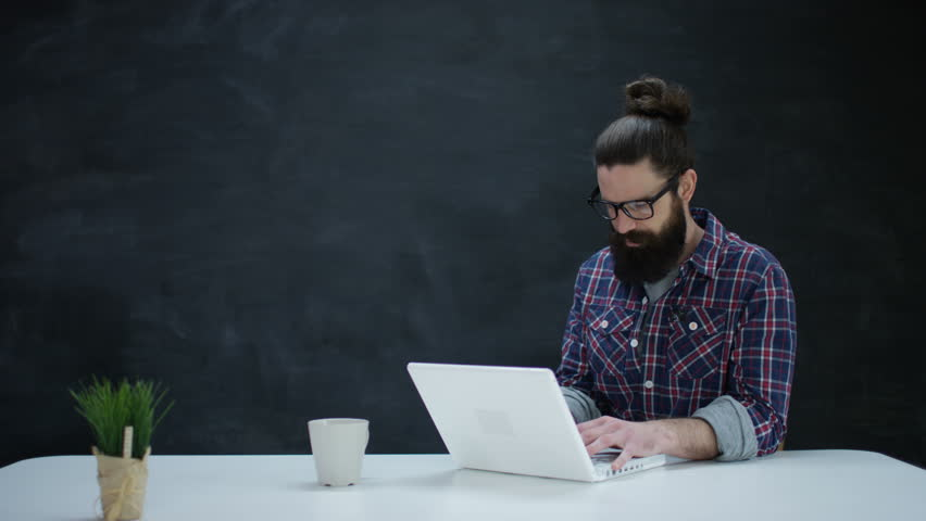4k hipster man using laptop computer thinking on blank 4k hipster man using laptop computer thinking on blank chalkboard background shot on red voltagebd Image collections