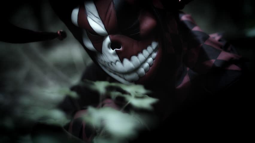 4k Halloween Shot of a Child in Joker Costume Appearing Creepy | Shutterstock HD Video #20253622