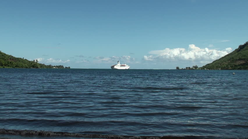 MOOREA ISLAND, FRENCH POLYNESIA - CIRCA JANUARY 2011: Astor cruise ship off Opunohu Bay, circa January 2011. This ship, registered at Nassau port, is under charter to the Germany-based Transocean Tours.