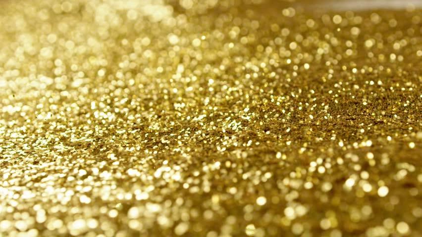 Golden glitter dynamic movements in slow motion | Shutterstock HD Video #20271574