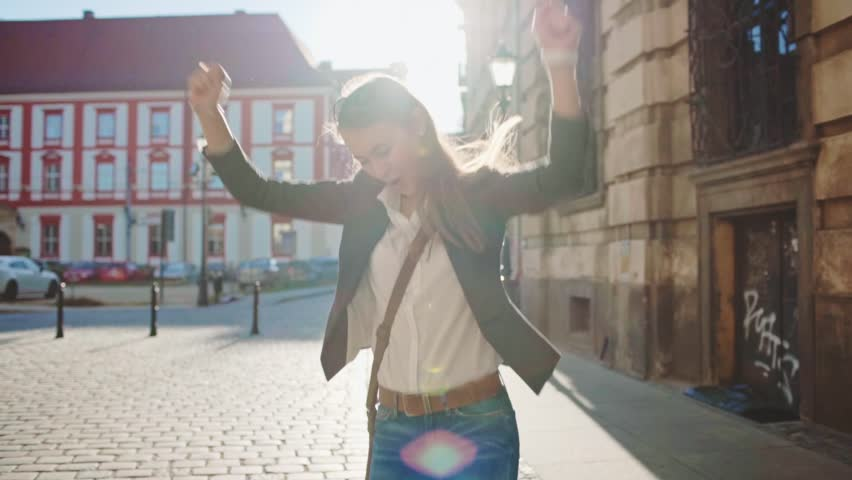 Happy Businesswoman Funky Dancing on the Sunny...