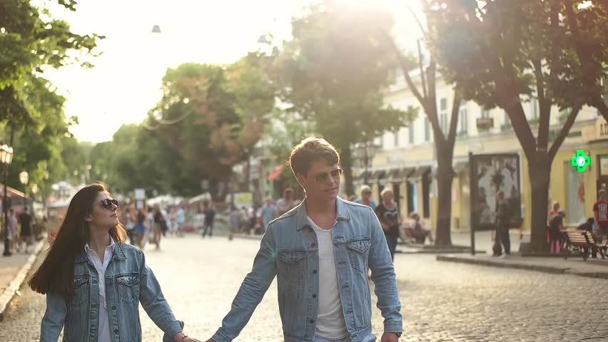 couple in denim shirts walking in the city.