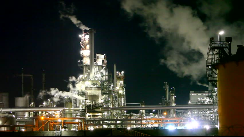 Petrochemical plant at night - smokestack