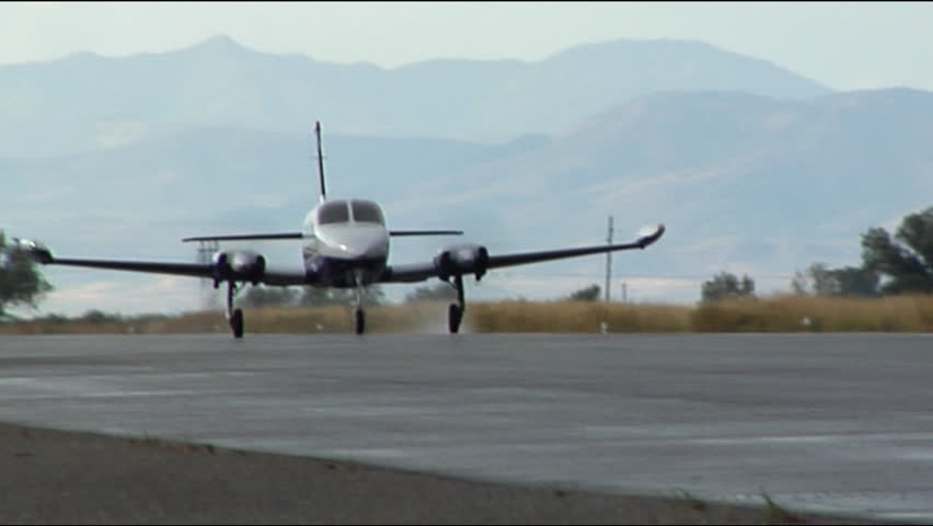 Twin Engine Plane Taking Off