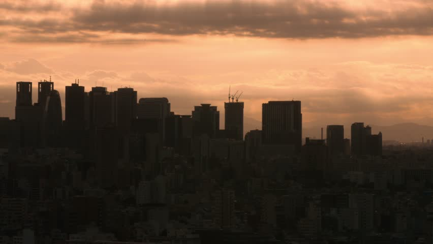 Bird's eye view of the dramatic sky over Tokyo cityscape before sunset, Tokyo, Japan