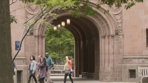 NEW HAVEN, CT- OCT 9: Diverse group of people walking through Yale University college campus Vanderbilt Hall on October 9, 2016. Yale University is an Ivy League university school founded in 1701.