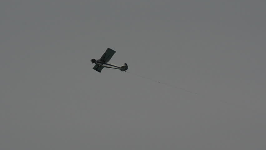 Banner towing airplane in flight