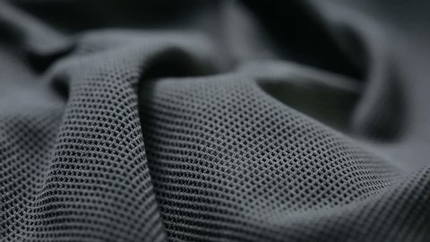 mesh cloth. black synthetic fabric. can be used as a background