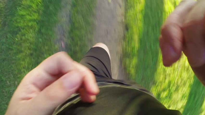 TOP VIEW: Man runs on a forest path (slow motion) | Shutterstock HD Video #20414593