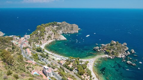 Isola Bella Wide Landscape at Taormina Italy on the Island of Sicily Featuring the Coastal Coves of the Popular Beaches during the Sunny Summer Vacation Season