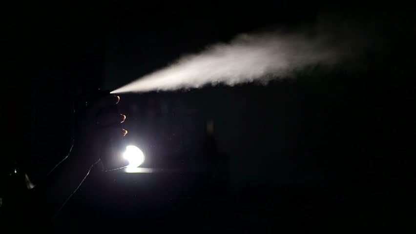 Spraying of spray of deodorant. Black background.