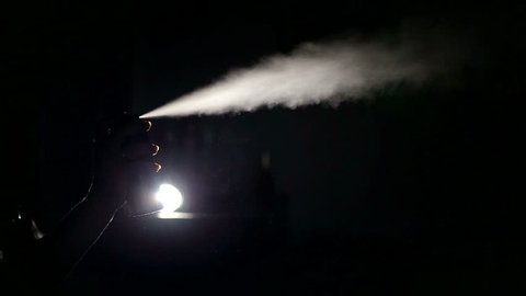Spraying of spray of deodorant. Black background.