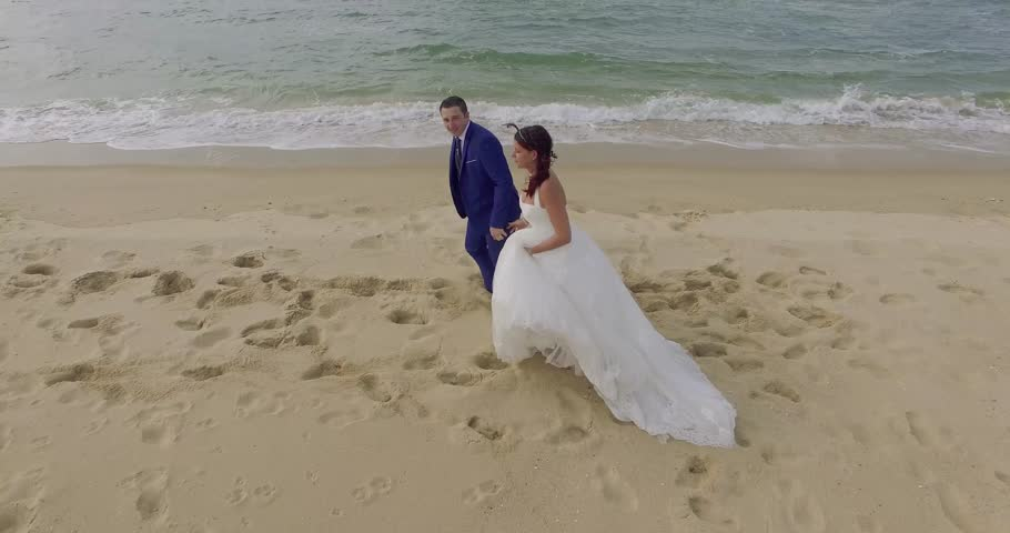 Happy just married young wedding couple celebrating and have fun at beautiful beach  | Shutterstock HD Video #20446093