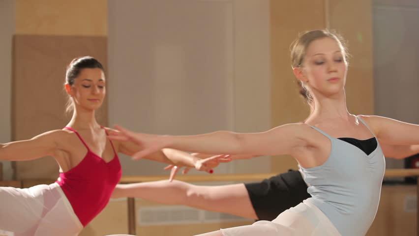 Several dancers performs jazz-modern dance