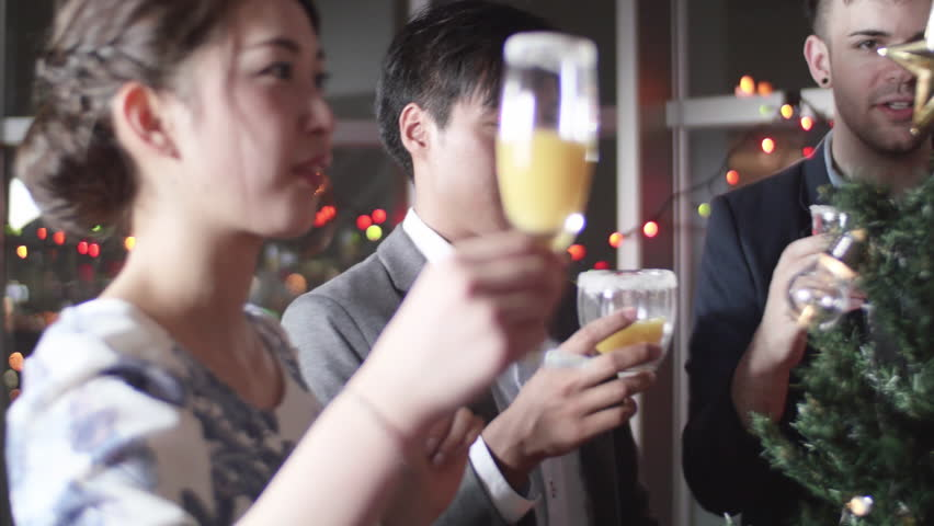 Group Of Friends Toasting At Christmas Party Japanese And International