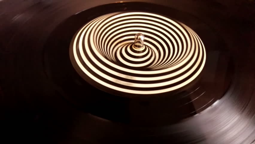 Spinning hypnotic vinyl on the turntable, creating beautiful magiclike visual illusion of never ending motion. | Shutterstock HD Video #20529133
