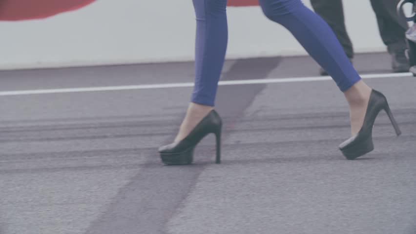 Slow motion shot of  female legs walking outdoors on high heels. | Shutterstock HD Video #20542543