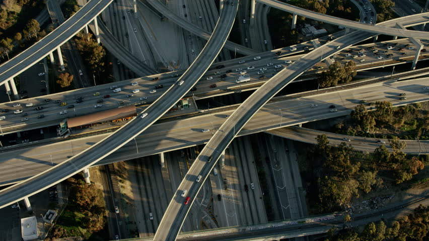 Aerial USA sunrise City Intersection traffic cars commuter Highway outdoor driving structure Urban travel Logistics
