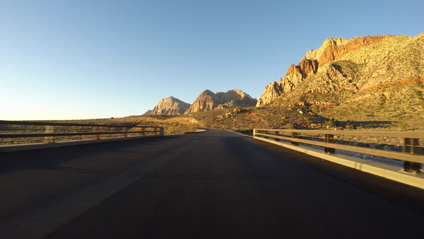 Sunrise driving at Red Rock Canyon National Conservation Area. A popular natural destination 20 miles from the Las Vegas strip.   Shutterstock HD Video #20577703