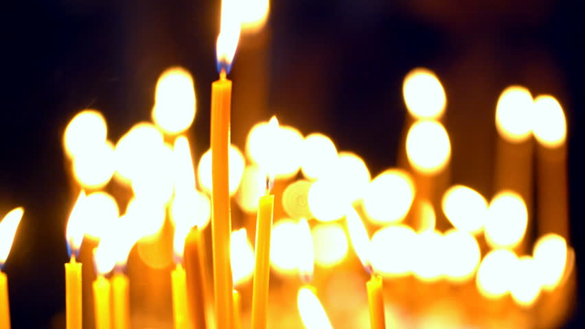 Many Church Candles Burning in the Temple of the Long-Range Plan is Not in Focus Icon in the Church Lighted Candles Candles Are Reflected in the Glass of the Icon With the Image of Christ Religion #20580343