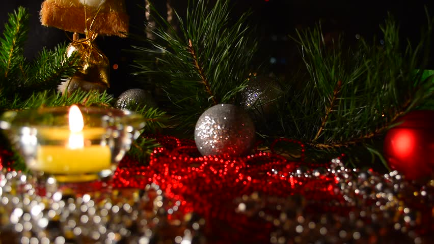 Advent celebration background. Advent collage with tree branches, candle, christmas balls and decoration. Candle light closeup at background of christmas decoration. #20626225