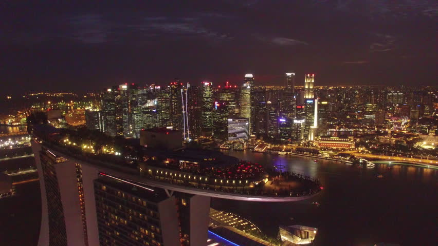 night view Singapore skyline flying over Marina Bay Sands Hotel