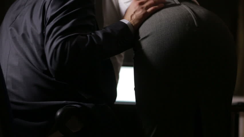 sexual relations at work. Young business couple are having sex in the workplace.