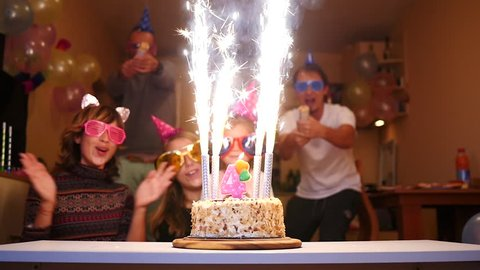 Cheering people birthday party - firework candles cake, colorful streamers confetti fly
