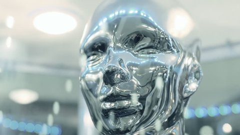 Silver color, mirror surfaces of face humanoid ( human ) reflects lights and rays of light from the surrounding space. Liquid metal face. Several options color correction. The camera moves around