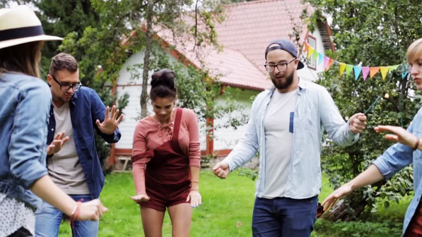 Leisure, holidays, fun and people concept - happy friends dancing at summer party in garden | Shutterstock HD Video #20705413