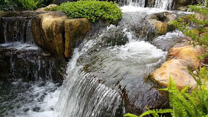 Beautiful waterfall in garden. Waterfall in garden