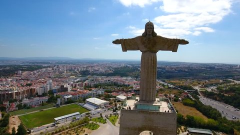 4K footage 360 degrees around the Jesus Christ monument (Cristo Rei) in Lisbon, Portugal, emblematic monument in Almada, Lisbon, Close-up aerial footage