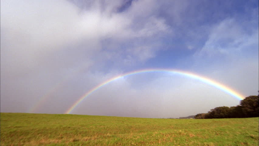 Day Rainbow clouds over green field prairie Green trees background | Shutterstock HD Video #20718427