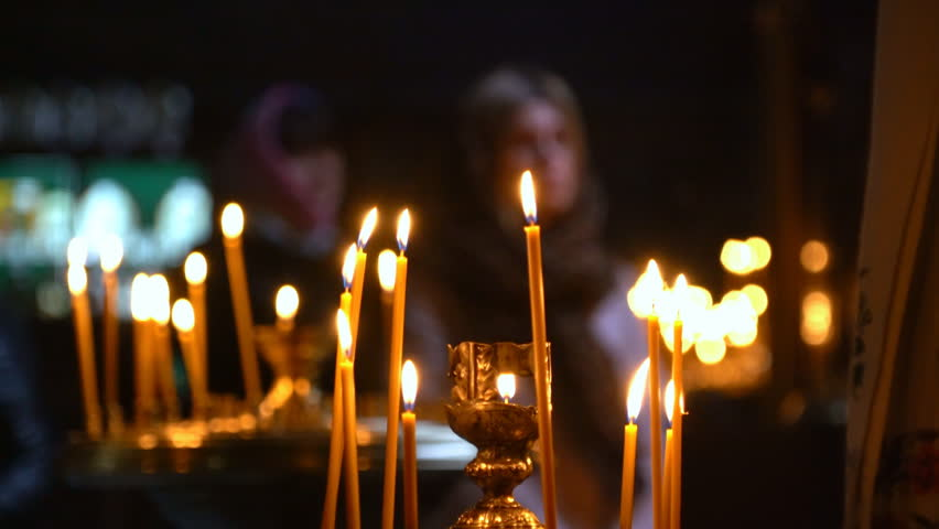 Candles Are Lit in the Foreground. the Church Came Luthi They Face Pray Candles, Crosses and Prayers. Buying and Placing Candles People Ask God For Forgiveness and Well-Being. Candles Burning in the